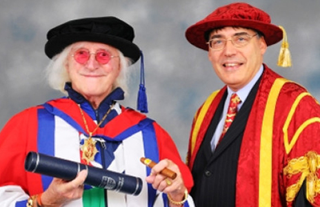 Savile is presented with Bedforshire University's honorary doctorate