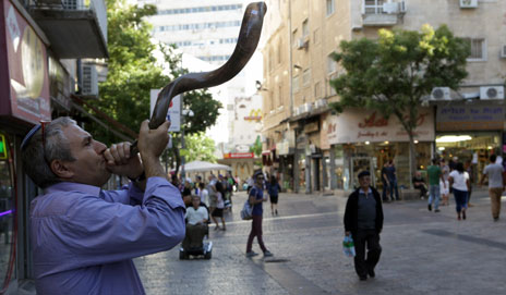 Shopkeeper plays a shofar