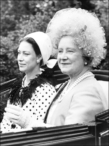 The Queen Mother Elizabeth and Princess Margaret arrive in an open carriage in 1967 at Ascot.