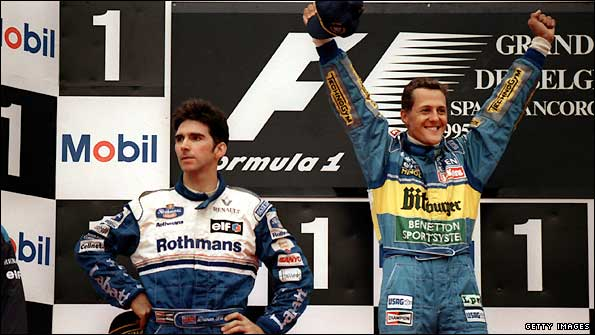 Michael Schumacher celebrates victory at Spa in 1995, Damon Hill does not seem quite so pleased with second
