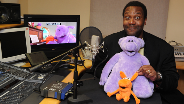 Lenny Henry hugging Big and Small in the studio