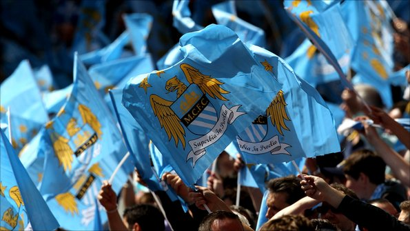 Man City fans waving flags