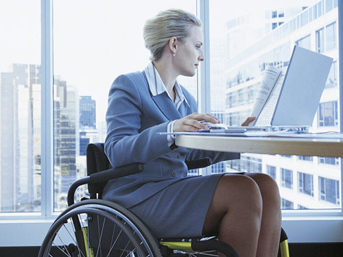 Businesswoman in wheelchair with laptop