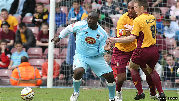 Adebayo Akinfenwa (left) in action for former club Northampton