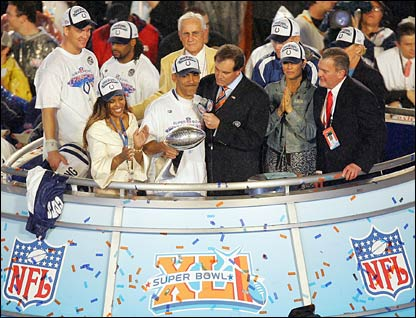 Head coach Tony Dungy of the Indianapolis Colts gets interviewed while holding the Super Bowl Trophy.jpg