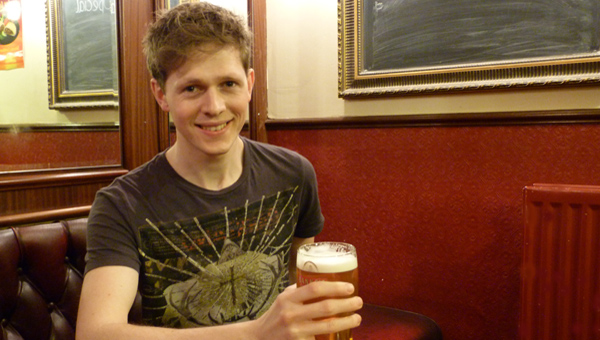 Scott Arthur plays Rhys, barman at The Bull