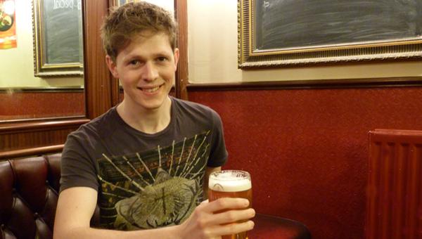 Scott Arthur plays Rhys, barman at The Bull
