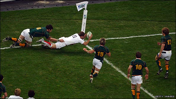 Mark Cueto prepares to touch the ball down but his try is ruled out