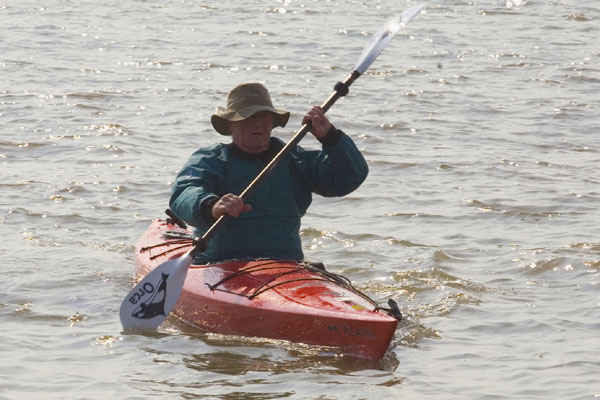 Bernard Hill as the canoe man paddles out to sea
