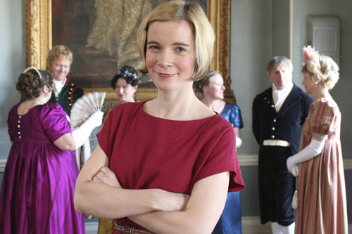 Lucy Worsley in front of group wearing Regency dress