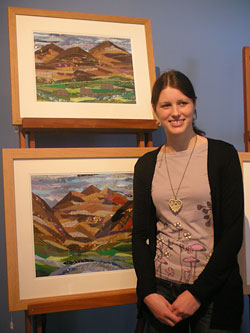 Josie Russell with some of her art work. Image courtesy of The National Trust