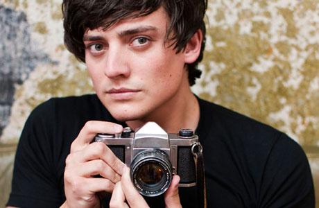 Aneurin Barnard holding a Pentax camera. Photo: BBC/Kudos