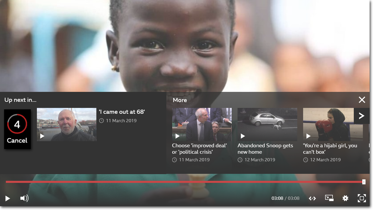 Image of a child smiling with Autoplay menu at bottom showing the Cancel option