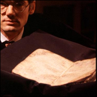 Dr William Noel displaying The Archimedes Manuscript; hidden under the ink of a prayer book is the earliest manuscript copy of Archimedes revolutionary mathematical theories.