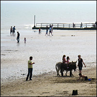 The seafront at Dymchurch, Kent, on a sunny day.