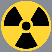Three vaguely triangular black shapes pointing towards a small circle on a yellow background - the symbol for radiation.
