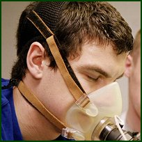 A student's respiratory capacity is tested.