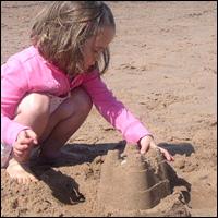 Building a sandcastle.