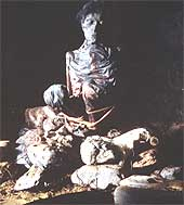 A mummy on a pile of rocks from a cave in South Uist