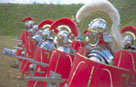A group of Roman soldiers advancing with spears at the ready