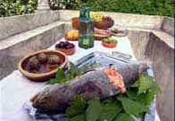 Photograph showing a table laid with various roman foods