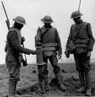 Photo of Irish soldiers examining a captured German machine gun