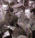 Photo of officers reading out news of the armistice to their men