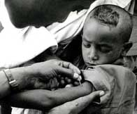 Image of a young boy receiving vacination against smallpox