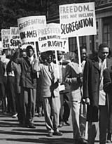 A picket line of African-American men and women demonstrates against segregation in South Chicago, Illinois