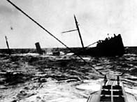 A black and white photograph of British ship sinking after a U-boat attack in the North Sea, 1916