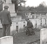 British soldiers inspect graves in the South African cemetery at Delville Wood 13 November 1944