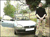 Sean Duffy in front of his car