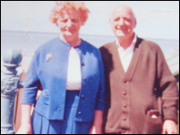 Joan's birth parents.
