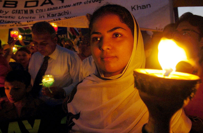 Pakistani participants hold lamps during an anti-TB day rally as they march in Karachi, 26 March 2006. World Health Organization (WHO) TB Control Coordinator Ammanullah Ansari said that as many as 1086 million people across the globe are infected with the disease.