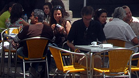 People in an outdoor café in Lisbon