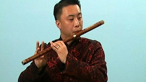 Playing melodies on the Chinese bamboo flute