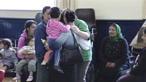Roma families return to homes in Belfast