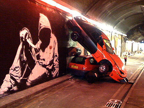 A vast outdoor mural by graffiti artist Banksy and other stencil artists