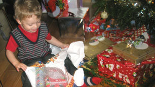 Laurence Clark's son, Tom, excitedly opening his Christmas presents last year