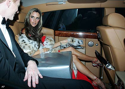 Victoria Beckham and friend. Look at the inside of her motor!