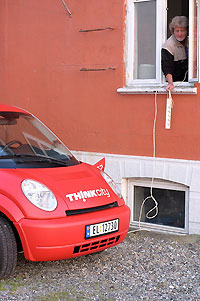 In port town of Kolby Kas on Samsø Island. Hotel owner Rene lets us charge our car via an extension cable into his kitchen. Photo credit: Richard Scrase.