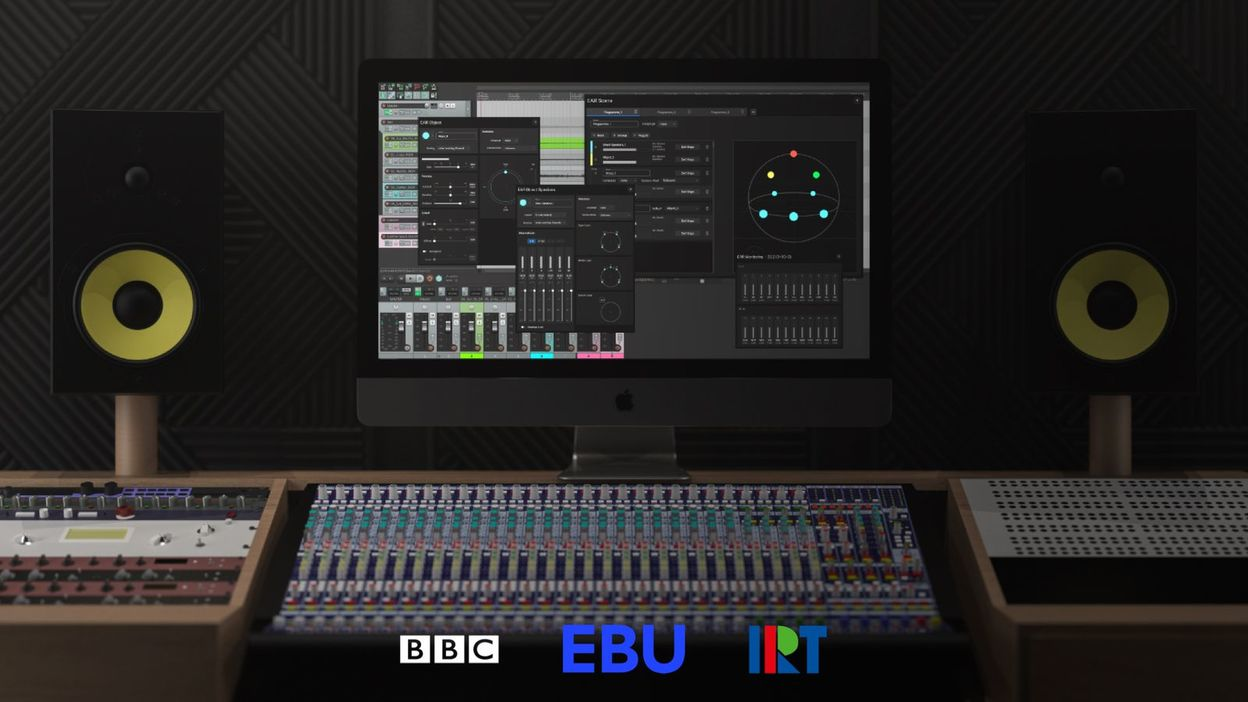 A computer audio editing workstation with mixing desk and speakers