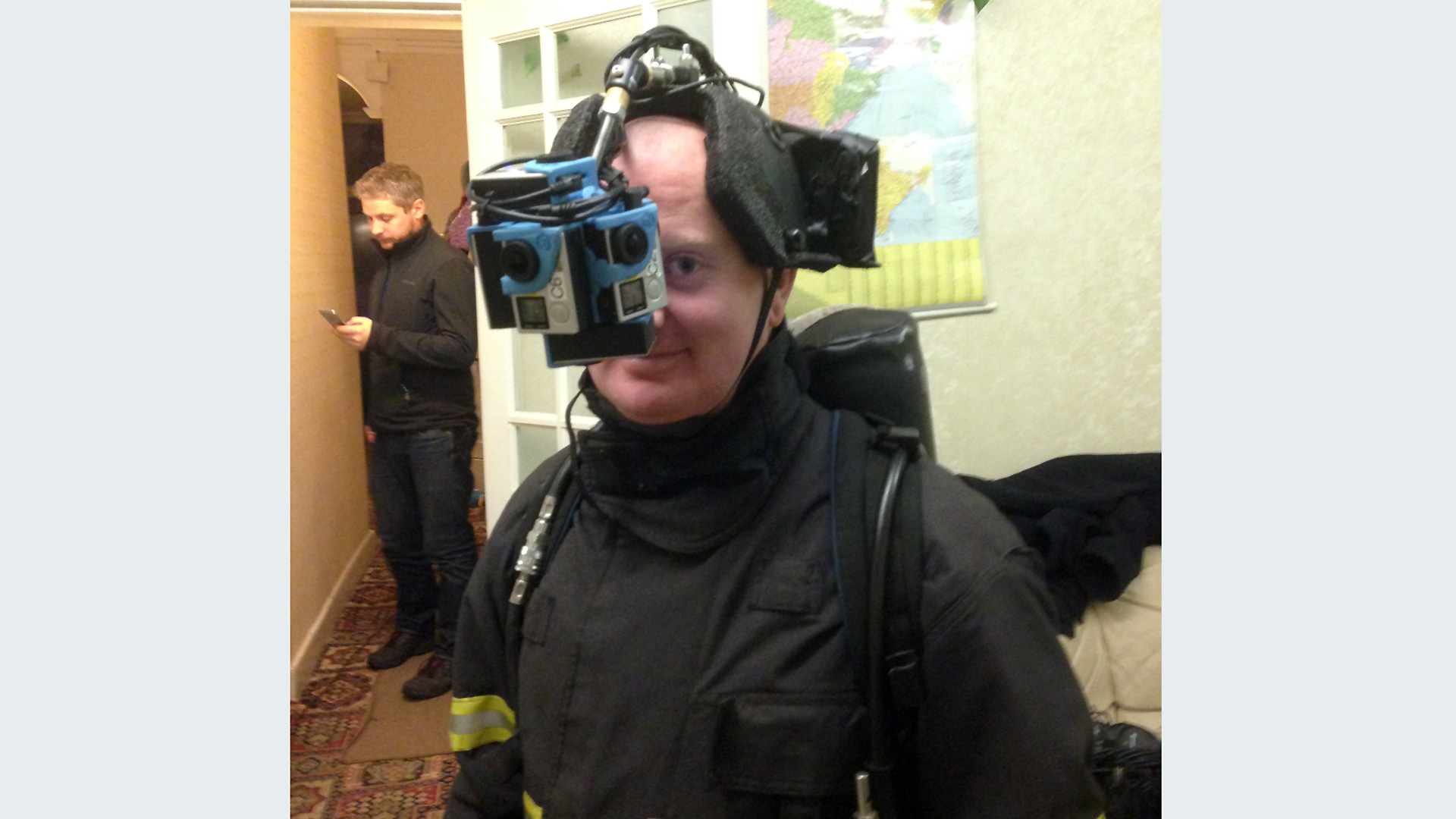 A fireman with a 360 camera rig hanging in front of his face