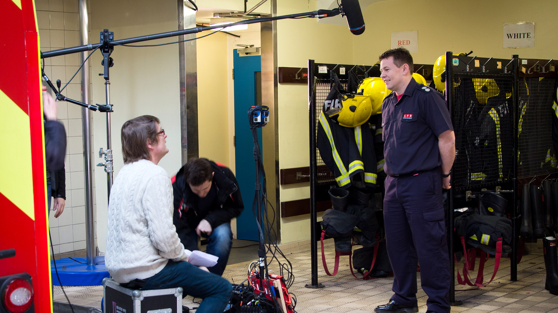 A fireman being interviewed in front of a 360 video camera