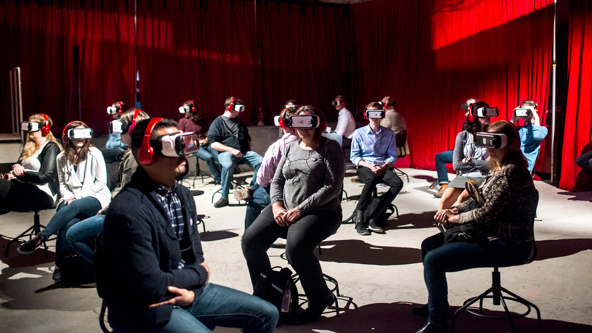 People trying Virtual Reality in the 2016 Festival of Future Storytelling VR Theater