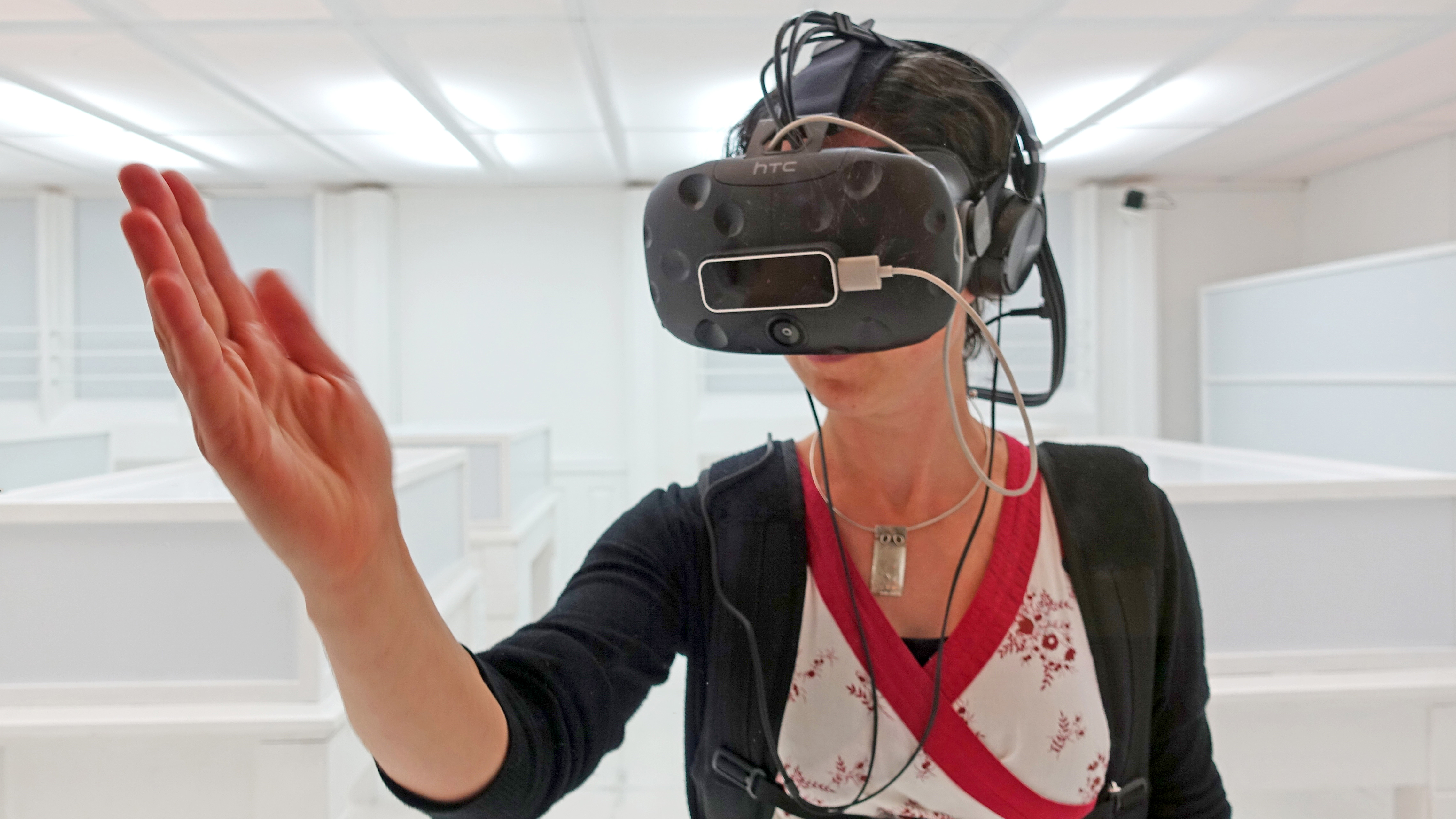 Woman trying a VR experience, wearing a VR headset