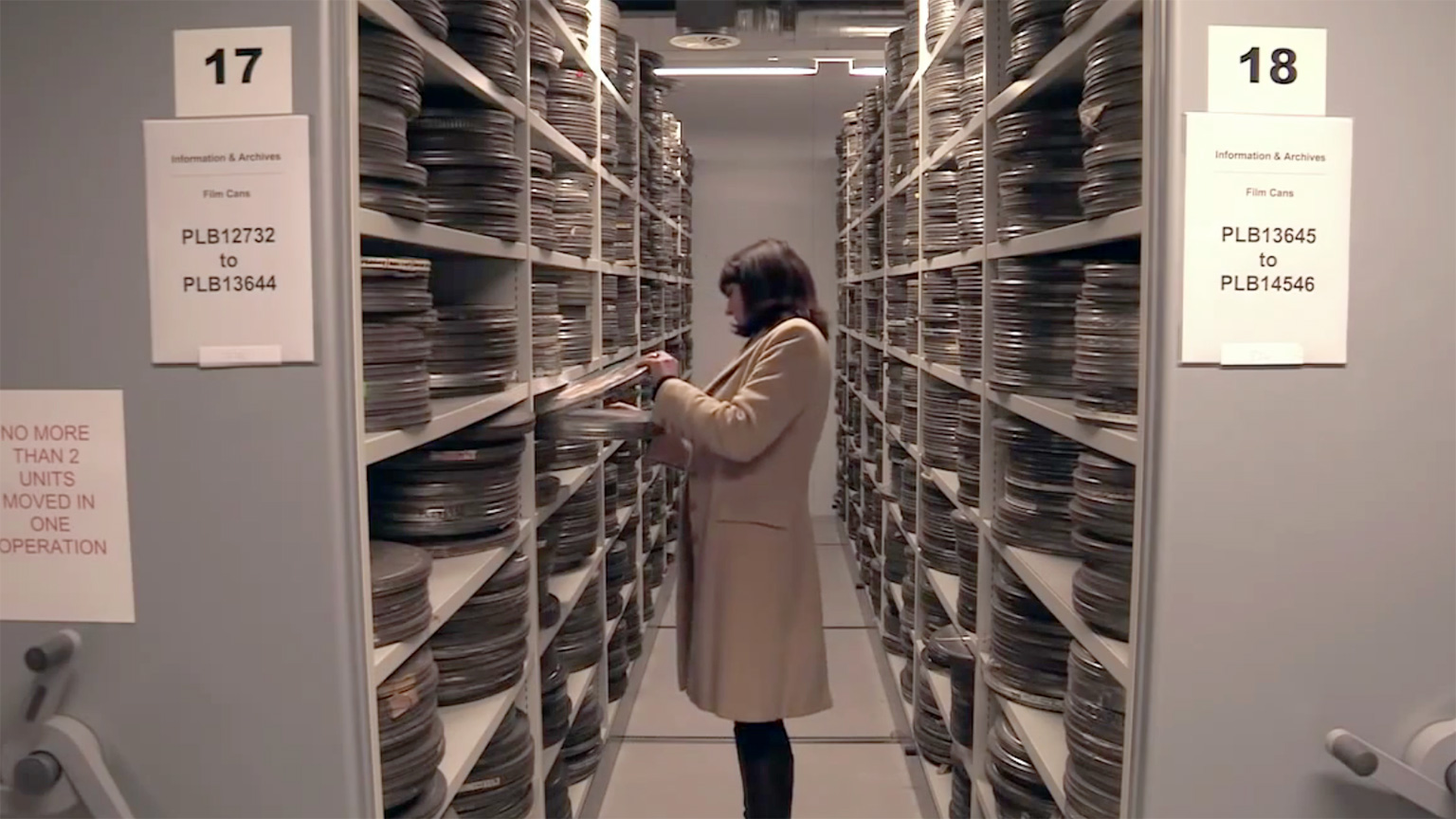 Woman looking through the shelves of television archives