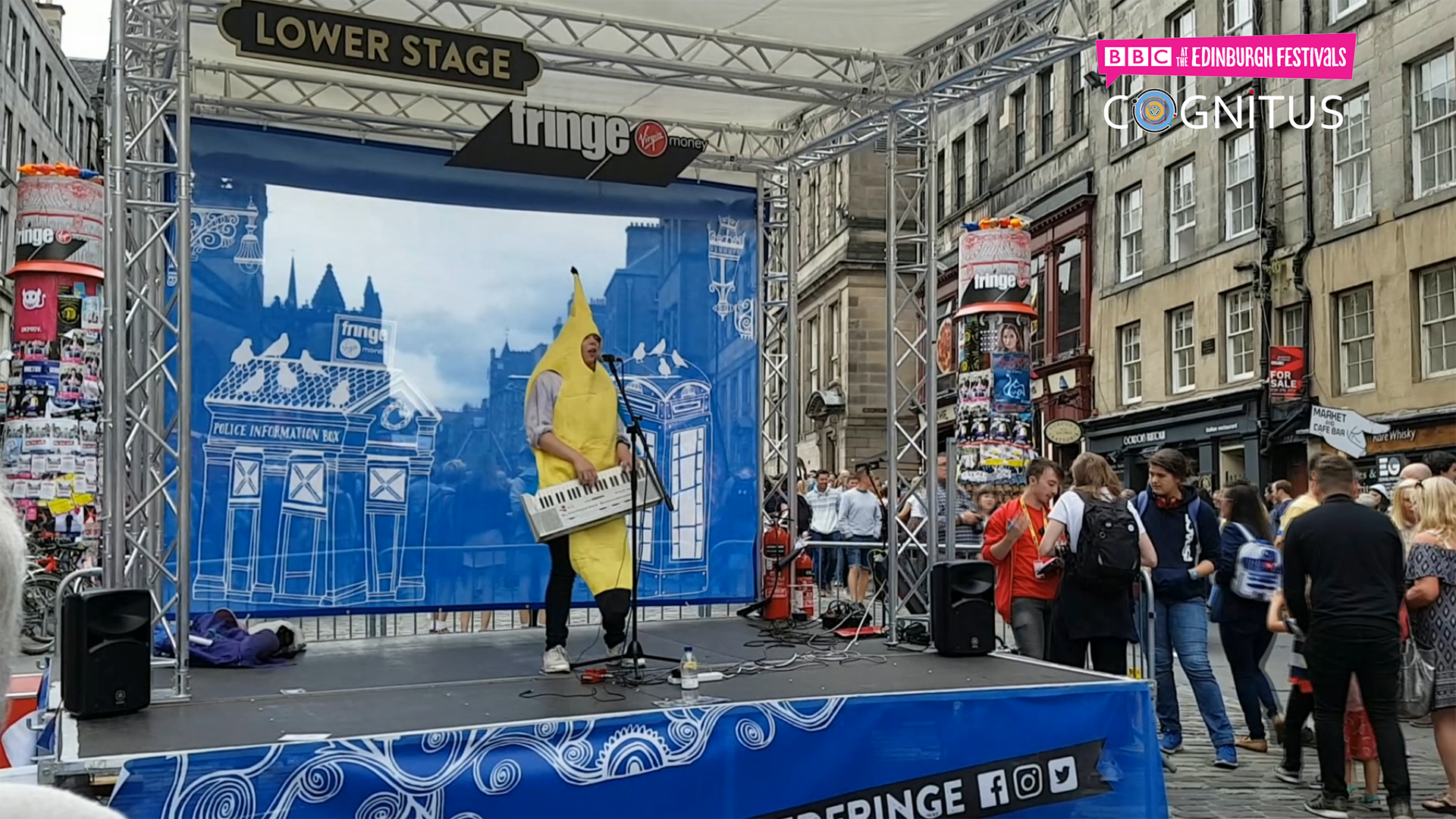 An image taken fro the video shoot trials of COGNITUS at the Edinburgh Festival - a man is dressed as a banana, playing the keyboard.