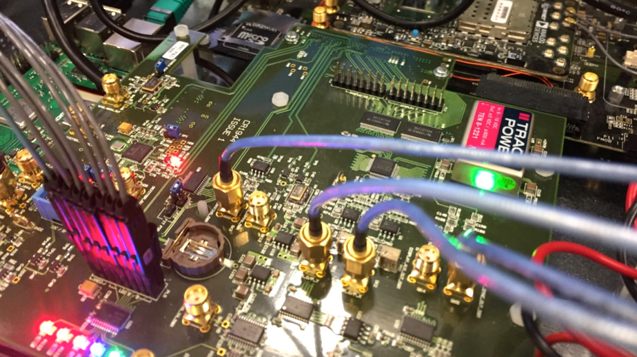 A close up image of motherboard with brightly lit LED lights from the 5G modem.