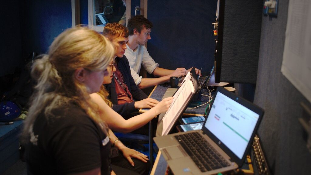 The production team operating the Notes app at the Proms